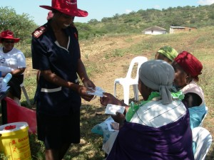 A health worker talks with member of the community